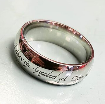 a wedding band featuring elvish script around the outside