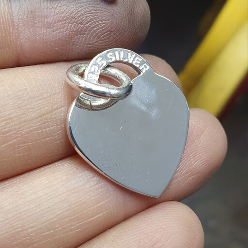 Sterling Silver heart having been polished